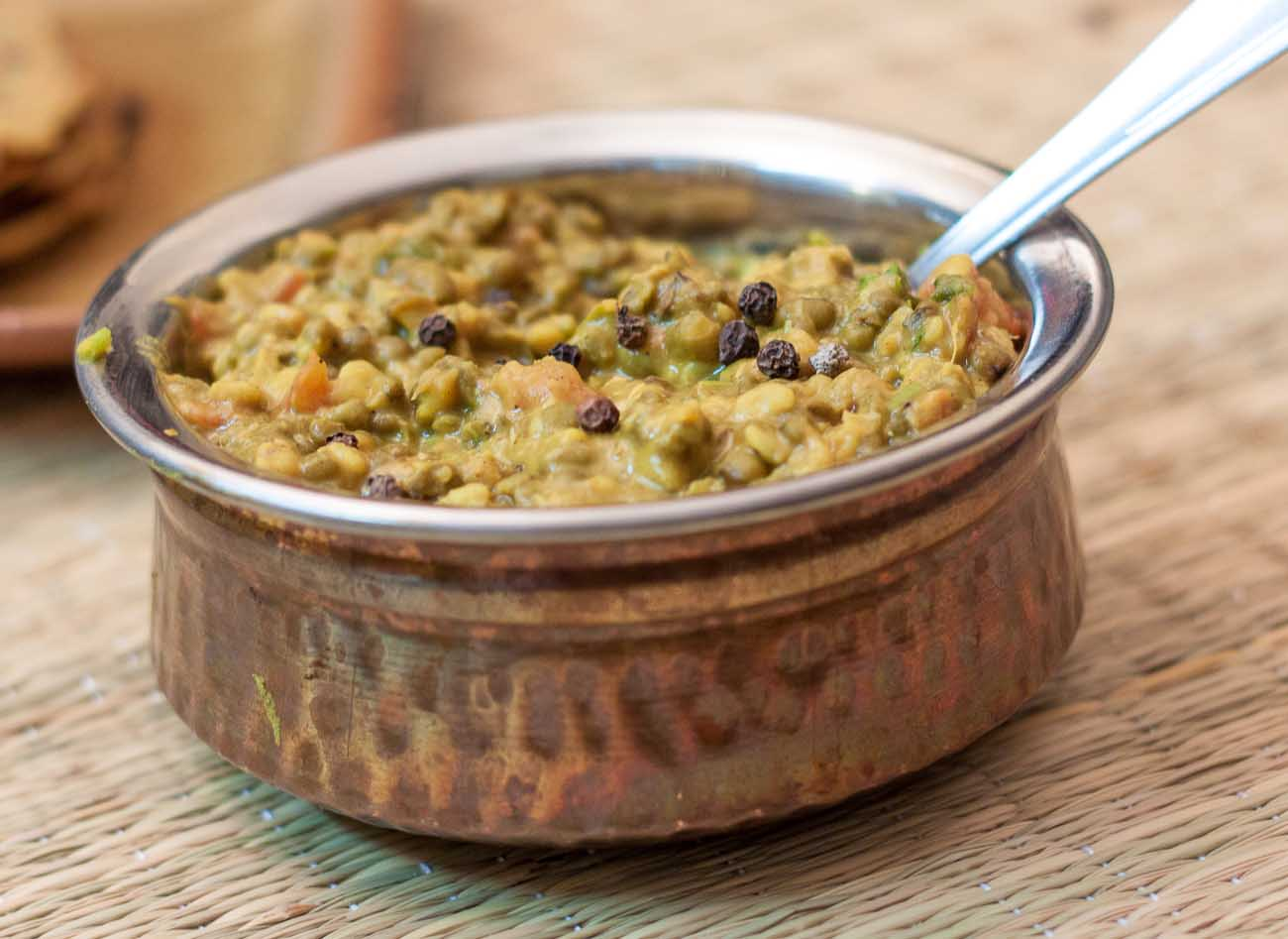 Green moong dal makhani recipe by archanas kitchen green moong dal makhani is a wholesome dal that is made just like dhaba dal of punjab made with green moong serve this dal with missi roti and lauki raita forumfinder Image collections