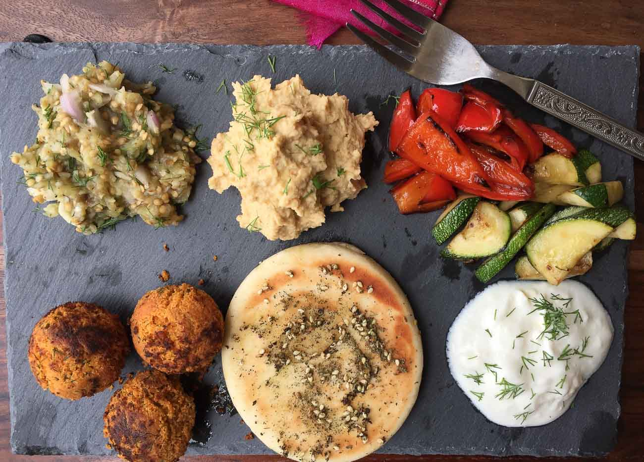 Mezze Platter Hummus Baba Ganoush Tzatziki Chickpea Falafel Pita Bread Stir Fried Vegetables By Archana S Kitchen