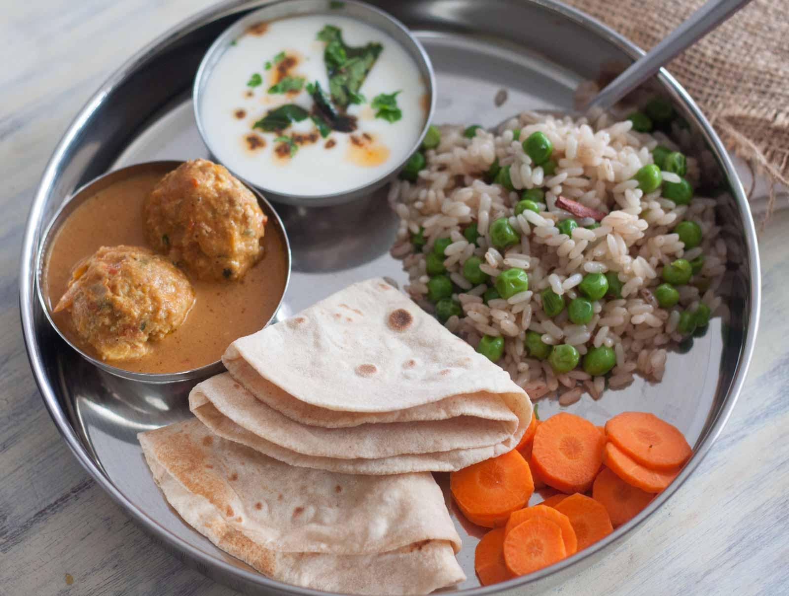 Non Veg Meal Plate Chicken Kofta CurryPeas PulaoTadka Raita Phulka