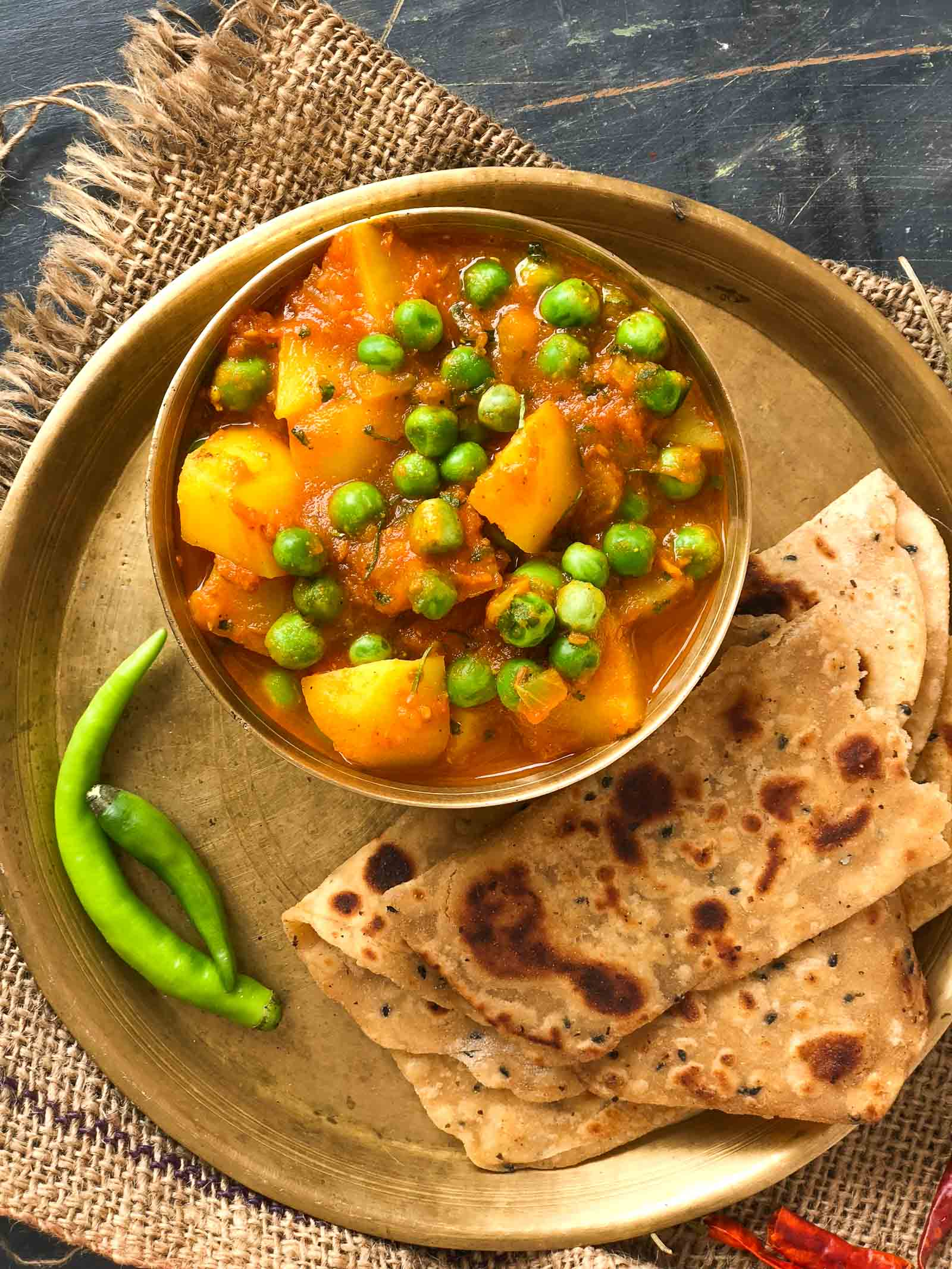 Aloo Matar Sabzi Recipe Potatoes Peas In Tomato Gravy By Archana S Kitchen