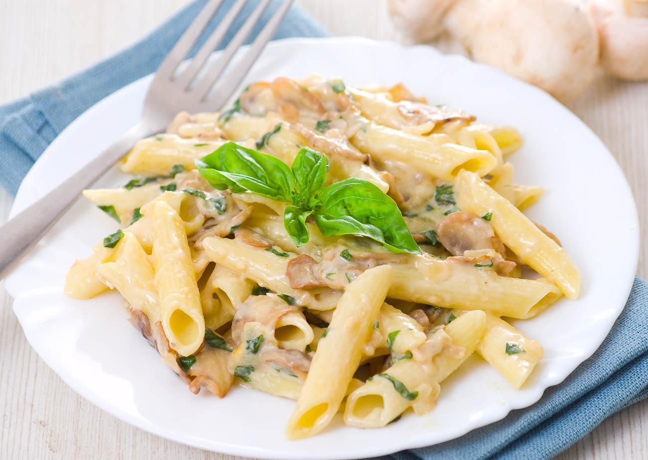 mushroom penne pasta recipe in alfredo sauce by archana s kitchen