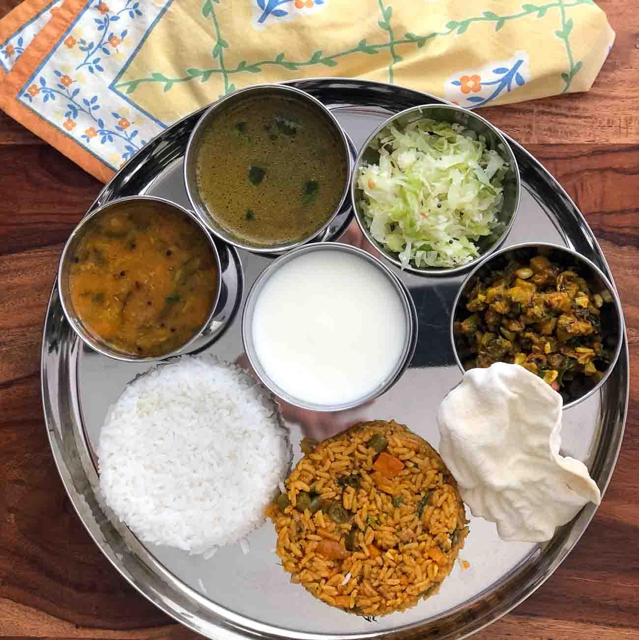 Everyday Meal Plate : Murungakkai Vendhaya Keerai Sambar, Jeera Milagu Rasam, Cabbage Poriyal, Pavakka Poriyal And Tomato Rice
