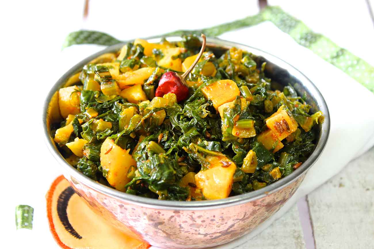 Aloo Aur Mooli Ke Patton Ki Sabzi Recipe - Radish Greens And Potato Stir Fry