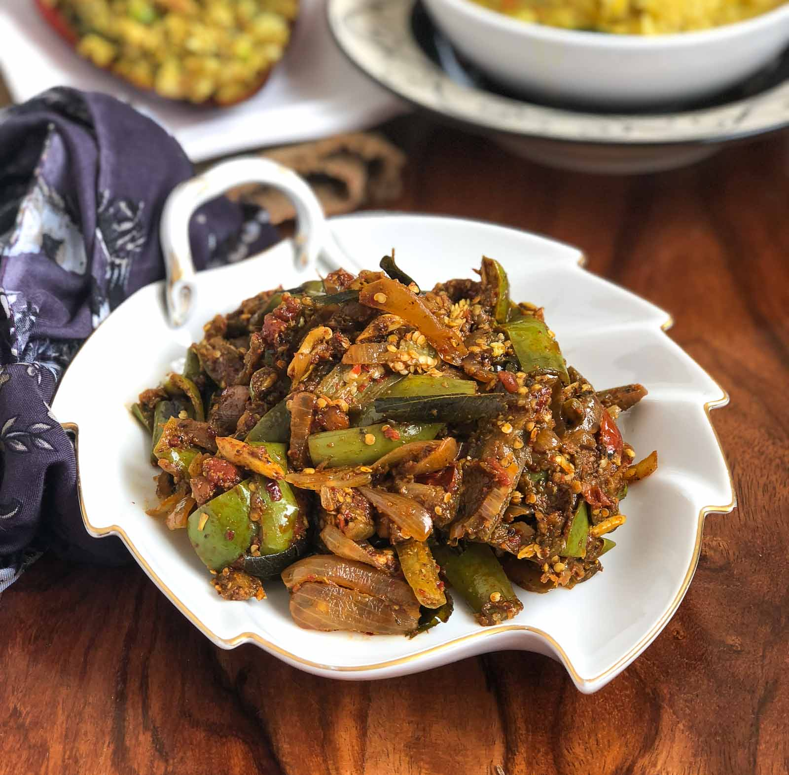Kathirikai Poondu Pirattal Recipe - South Indian Style Brinjal Stir Fry With Garlic