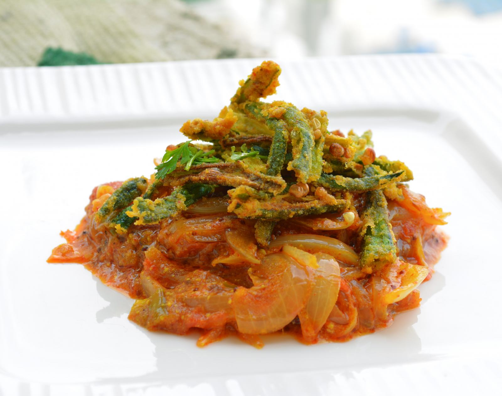 Kurkuri Bhindi With Spicy Tomato Yogurt Gravy Recipe