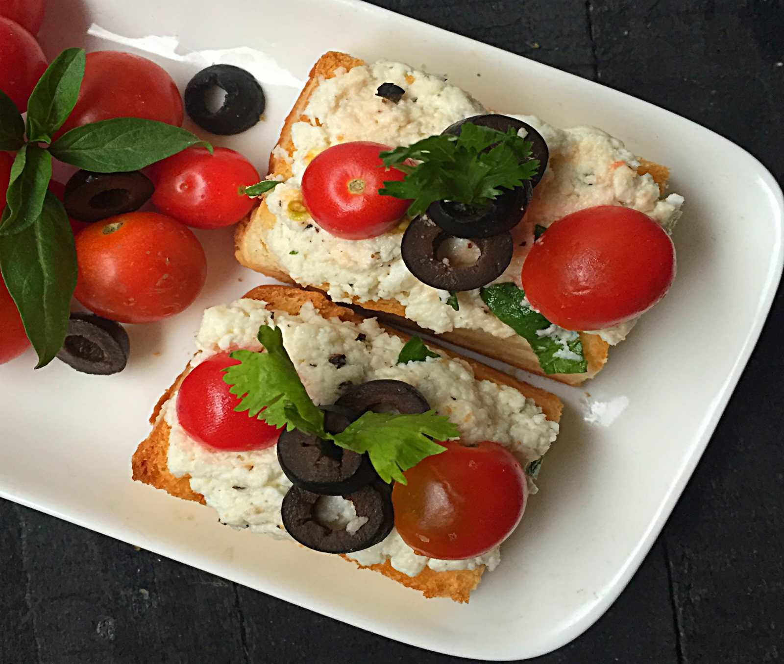 Italian Ricotta Crostini with Olives and Cherry Tomatoes Recipe