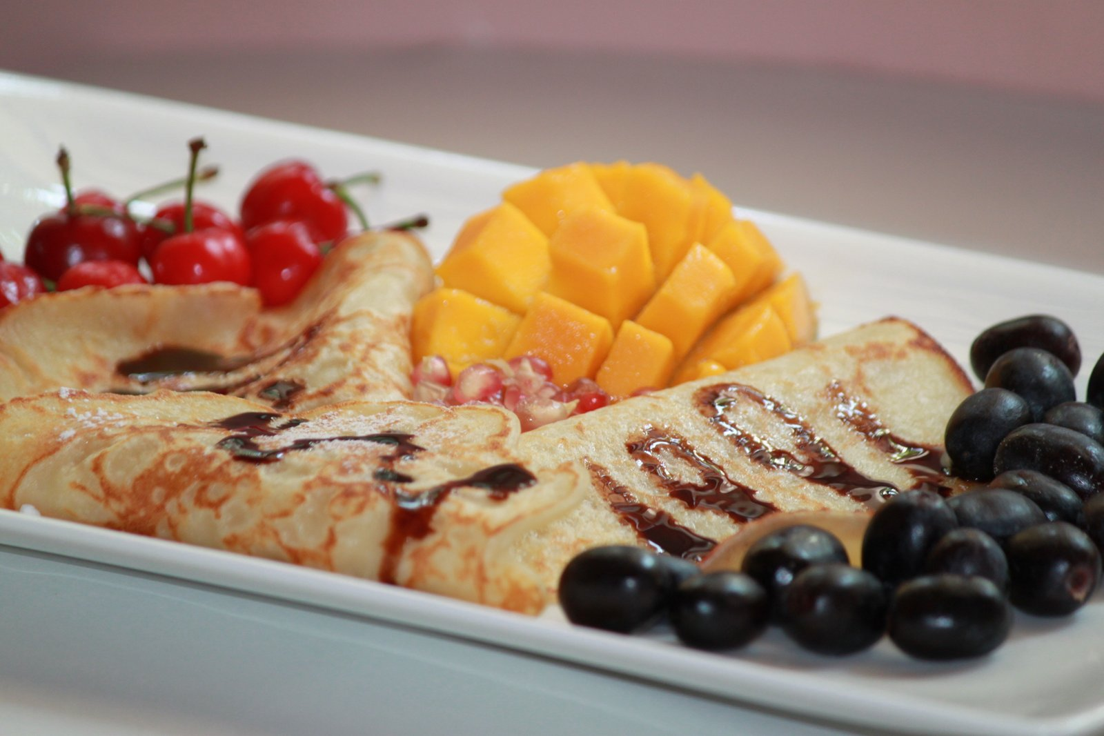 Pancakes Drizzled With Chocolate Sauce Served Fruits Jaggery Recipe Breakfast In Bed