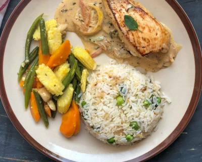 Enjoy A Weekend Dinner With Chicken In Lemon Butter Sauce, Steamed Vegetables & Herbed Rice