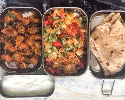 Kids Lunch Box: Patiala Aloo, Carrot Cucumber Tomato Salad And Phulka