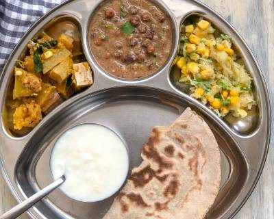 Portion Control Meal Plate: Malvani Kala Chana Masala, Bhoplya Cha Bharit, Phulka, Salad And Curd