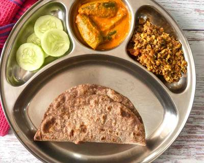 Portion Control Meal Plate- No Onion No Garlic Parwal Masala, Horse Gram Sprouts Thoran, Ragi Roti & Cucumbers