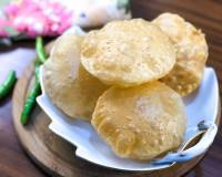 Puri Recipe - Learn to Make Soft Puffed Puris At Home