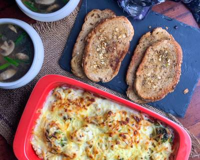 Comforting Cheesy Meal Of Creamy Au Gratin With Soup And Bread For Dinner