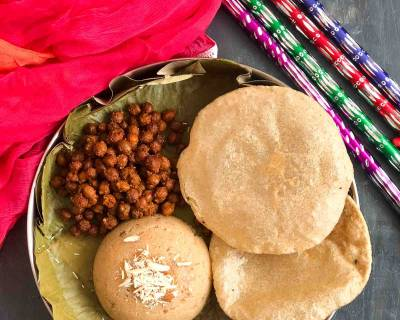 Enjoy A Festive Meal Of Sukha Kala Chana, Puri and Sooji Halwa