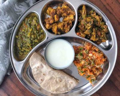 Portion Control Meal Plate: Dal Palak, Arbi Ajwain Sabzi, Tawa Mushroom, Carrot & Tomato Salad And Homemade Curd