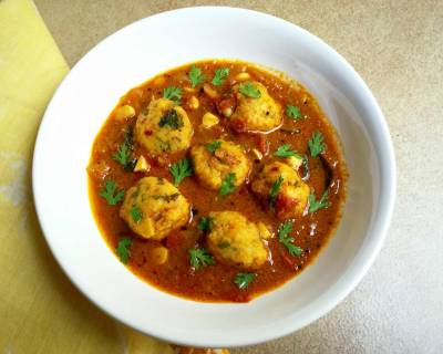 Chettinad Paruppu Urundai Kuzhambu (Steamed Lentil Balls Cooked in a Tangy Curry) Recipe