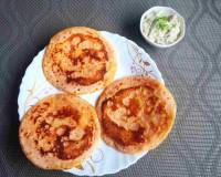Spicy Tomato Uttapam With Garlic Recipe