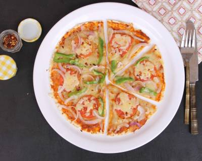 Tortilla Pizza With Tomato, Onion And Capsicum Recipe
