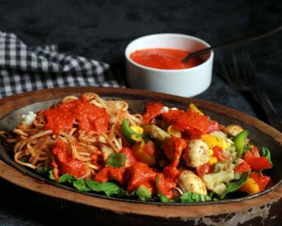 Noodle Sizzler With Garlic Pepper Sauce And Baked Vegetables Recipe