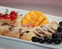 Pancakes Drizzled With Chocolate Sauce Served With Fruits & Jaggery Recipe (Breakfast In Bed)