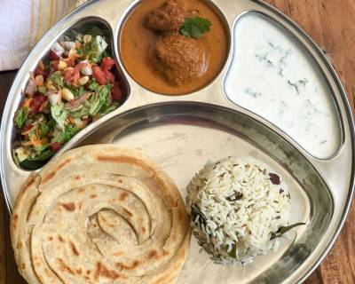 Try Our Lip-Smacking South Indian Meal With Ghee Rice Malabar Paratha Raita Salad & Paniyaram Muttai Masala