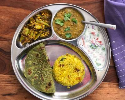 Portion Control Meal Plate: Palak Paratha, Mirch Ki Sabzi, Panchmel Dal, Lemon Rice & Raita