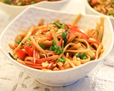 Cold Asian Noodle Salad Flavoured With Peanuts And Sesame